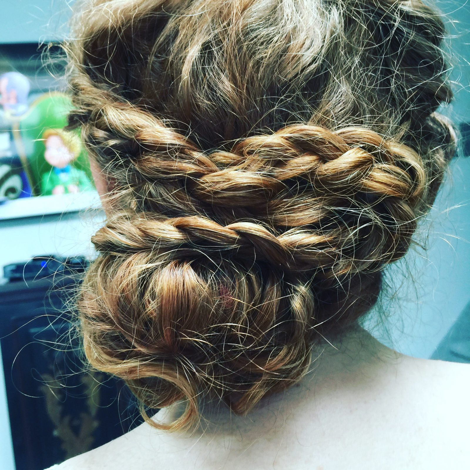 curly hair updo with braids